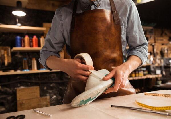 cropped-image-cobbler-modeling-design-shoe_171337-12238